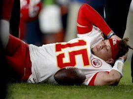 Medical staff attend to KC Chiefs QB Patrick Mahomes after injuring his knee against the Denver Broncos on Thursday Night Football. (Image: Porter Lambert/Getty)
