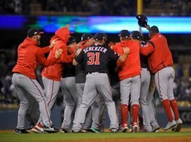 Max Scherzer and his Washington Nationals teammates celebrate defeating the LA Dodgers in Game 5 of the 2019 NLDS at Dodger Stadium. (Image: Mark J. Terrill/AP)