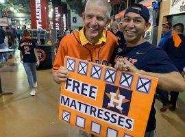 "Furniture store owner and local celebrity Jim ""Mattress Mack"" McIngvale poses with a fan during a World Series game at Minute Maid Park in Houston. (Image: Darren Rovell/Twitter)"