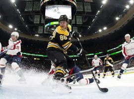Boston Bruins winger David Pastrnak attempts a deflection against the Washington Capitals. (Image: Winslow Townson/USA Today Sports)