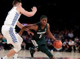 Michigan State point guard Cassius Winston is defended by Kentucky forward Nate Sestina at the Champions Classic at Madison Square Garden in NYC. (Image: Adam Hunger/AP)