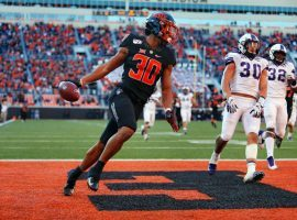 Oklahoma State running back Chuba Hubbard has been a beast this year, running for 1,726 yards and 20 touchdowns through 10 games. He'll be a key component of DFS lineups again this Saturday. (Image: Forbes)