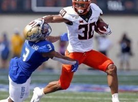 Chuba Hubbard, Grant Wells Likely to Shine in College Football DFS