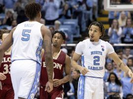 North Carolina guard Cole Anthony (right) celebrates a big shot with Armando Bacot (5) during a victory over Elon in Chapel Hill, NC. (Image: Ben McKeown/AP)