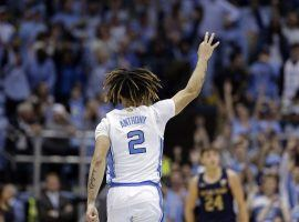North Carolina freshman guard Cole Anthony celebrates hitting a three-pointer in a comeback victory over Notre Dame in Chapel Hill, NC. (Image: Gerry Bloom/AP)