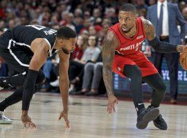 Damian Lillard blows by Brooklyn Nets guard Garret Temple during his 60-point career night in Portland. (Image: Craig Mitchelldyer/AP)