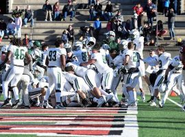 Dartmouth football players celebrate their Hail Mary victory on the last play of the game against Harvard. (Image: AP)