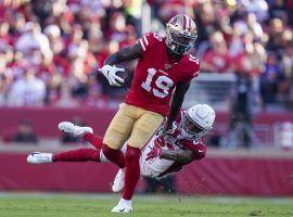 San Francisco 49ers WR Deebo Samuel evades an Arizona Cardinals' defender at Levi Stadium in Santa Clara, Ca. (Image: Kyle Terada/USA Today Sports)