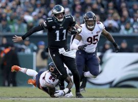 Philadelphia Eagles QB Carson Wentz evades the Chicago Bears defense. (Image: Brad Penner/AP)