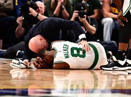 Boston Celtics medical staff attended to guard Kemba Walker after a collision with a teammate against the Denver Nuggets at the Pepsi Center in Denver, Co. (Image: Ron Chenoy/USA Today Sports)
