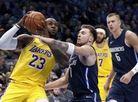 Dallas Mavericks swingman Luka Doncic defends LA Lakers forward LeBron James in an overtime loss in Dallas. (Image: Tony Gutierrez/AP)