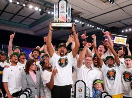 Michigan head coach, Juwan Howard (center), holds up the winner's trophy at the Battle 4 Atlantis in the Bahamas. (Image: Kevin Jairaj/USA Today Sports)