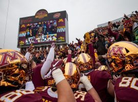 Minnesota Gophers football players celebrate with students and fans after their 31-26 upset victory over #4 Penn State at TCF Bank Stadium in Minneapolis. (Image: Jesse Johnson/USA Today Sports)