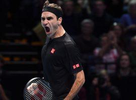 Roger Federer beat Novak Djokovic in straight sets to reach the semifinals at the ATP Finals in London. (Image: Alberto Pezzali/AP)