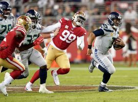 Seattle Seahawks QB Russell Wilson escapes a pass rush from the San Francisco 49ers at Levi Stadium in Santa Clara, CA. (Image: Thearon W. Henderson/Getty)