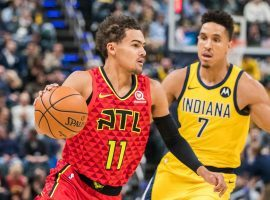 Atlanta Hawks guard Trae Young drives by Indiana Pacers point guard Malcolm Brogdon during an overtime loss in Indianapolis. (Image: Trevor Ruszkowski/USA Today Sports)