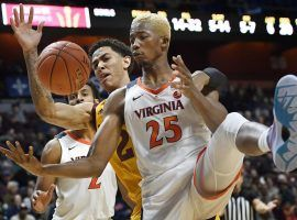 Arizona State forward Jalen Graham and Virginia forward Mamadi Diakite (25) fight for the ball during the Hall of Fame Tip Off at Mohegan Sun Arena. (Image: AP)