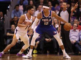 Philadelphia 76ers swingman Tobias Harris takes Phoenix Suns guard Devin Booker one-on-one in Phoenix. (Image: Christian Peterson/Getty)