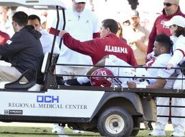 Alabama quarterback Tua Tagovailoa is carted off the field after an injury in the second quarter against the Mississippi State Bulldogs. (Image: Matt Bush/USA Today Sports)