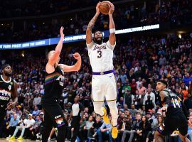 Lakers center Anthony Davis drives to the basket against the Denver Nuggets at the Pepsi Center in Denver, CO. (Image: Ron Chenoy/USA Today Sports)