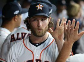 Ex-Houston Astros pitcher Gerrit Cole gets a high-five from teammates in Houston during the 2019 ALCS. (Image: Porter Lambert/Getty)