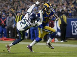 LA Rams RB Todd Gurley stiff arms Seattle Seahawks CB Tre Flowers during a victory in Week 13. (Image: Kyusung Gong/AP)