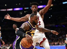 LeBron James of the LA Lakers drives against Miami Heat guard Jimmy Butler during a 95-80 victory at Staples Center in Los Angeles. (Image: Sean M. Haffey/Getty)