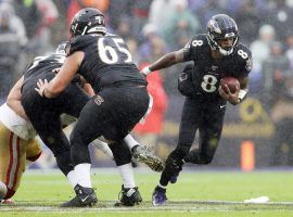 Baltimore Ravens RB Lamar Jackson evades the San Francisco pass rush during Week 13. (Image: Patrick Smith/Getty)