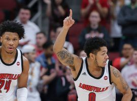 Louisville freshman Dwayne Sutton (24) and Senior Lamarr Kimble (0) run back on defense after a fast break at the Yum Center in Louisville. (Image: Dominique Yates/Louisville Courier Journal)