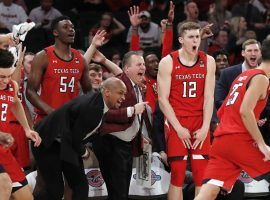 The Texas Tech bench celebrates during their 70-57 upset victory over #1 Louisville at MSG in New York City. (Image: Kathy Willens/AP)