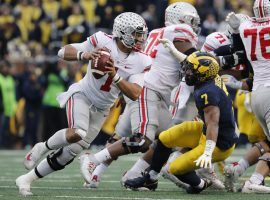 Ohio State quarterback Justin Fields has a knee injury that may limit his mobility in the Buckeyes-Tigers College Football Playoff Semifinal Fiesta Bowl game. (Image: USA Today Sports)