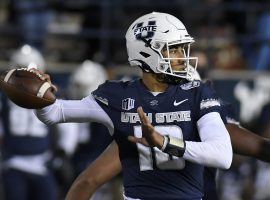 Despite being cited for marijuana possession last Saturday, Utah State quarterback Jordan Love will compete in the Frisco Bowl on Friday against Kent State. (Image: AP)