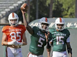 Miami quarterbacks N'Kosi Perry (5) and Jarren Williams (15) still don't know who will start in Thursday's Independence Bowl, but Hurricanes coach Manny Diaz said he will make a decision soon. (Image: Florida Sun-Sentinel)