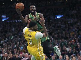 Boston Celtics guard Jaylen Browns drives to the hoop against LA Lakers center Anthony Davis in a blowout at TD Garden in Boston. (Image: Charles Krupa/AP)