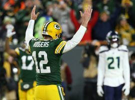 Green Bay Packers QB Aaron Rodgers celebrates a touchdown during a victory over the Seattle Seahawks in the NFC Divisional round in Green Bay, WI. (Image: Dylan Buell/Getty)