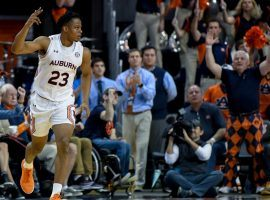 Auburn swingman Isaac Okoro (23) celebrates knocking down a three-pointer against Georgia. (Image: Julie Bennett/AP)