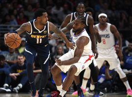 Denver Nuggets point guard Monte Morris defended by LA Clippers forward Kawhi Leonard at the Pepsi Center in Denver. (Image: Harry How/Getty)