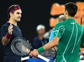 Novak Djokovic (right) defeated an injured Roger Federer (left) to reach the Australian Open final for the eighth time. (Image: Getty)