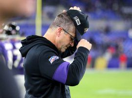 Baltimore coach John Harbaugh can barely watch as his team suffered an early exit in the playoffs after the Tennessee upset. (Image: Getty)