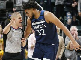Minnesota Timberwolves center Karl-Anthony Towns chats with an official during a game against the Indiana Pacers. (Image: Getty)