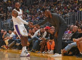 LeBron James joking with Kobe Bryant during a LA Lakers game at Staples Center in LA. (Image: Getty)