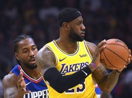 LA Clippers forward Kawhi Leonard (left) guards LA Lakers star LeBron James during a Christmas evening game in Los Angeles. (Image: Porter Lambert/Getty)