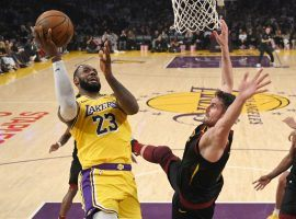 LeBron James of the LA Lakers drives to the basket against Kevin Love of the Cleveland Cavaliers during a game at Staples Center in Los Angeles. (Image: AP)