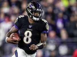 Baltimore Ravens QB, Lamar Jackson, torched the NY Jets on Thursday Night Football in Week 15 and broke Michael Vick's single season QB rushing record. (Image: AP)