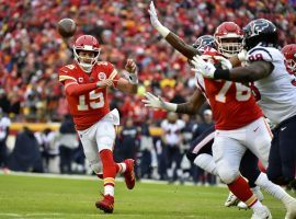 Patrick Mahomes of the Kansas City Chiefs tosses a touchdown pass against the Houston Texans during an AFC Divisional round playoff game. (Image: Ed Zurga/AP)