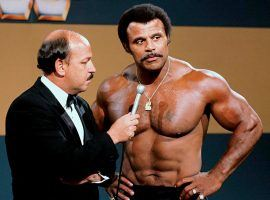 """Mean"" Gene Okerlund interviews Rocky Johnson during a WWE broadcast in the early 1980s. (Image: WWE)"