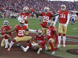 The San Francisco 49ers defense celebrates an interception by Richard Sherman (25) against the Minnesota Vikings at Levi Stadium in Santa Clara, CA. (Image: Marcio Jose Sanchez/AP)
