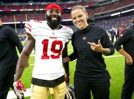 Katie Sowers, picture s  with former 49ers reciever Aldrick Robonson, will become the first woman and openly gay Super Bowl coach. (Image: Michael Zagaris/Getty)
