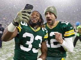 Packers running back Aaron Jones, left, has given quarterback Aaron Rodgers a reliable running game, and could be the deciding factor in the Seattle-Green Bay NFC Divisional Playoff game Sunday at Lambeau Field. (Image: AP)