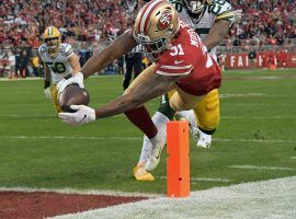 San Francisco 49ers RB Raheem Mostert dives for a touchdown during a victory over the Green Bay Packers in the NFC Championship at Levi Stadium in Santa Clara, CA. (Image: Kyle Terada/USA Today Sports)